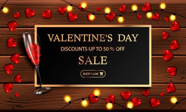 Saldi di san valentino, fino al 50% di sconto, moderno banner orizzontale o poster con una ghirlanda gialla Vettore Premium