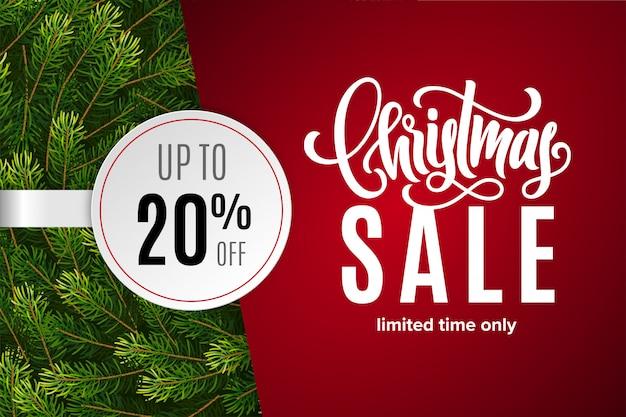 Saldi natalizi 20% di sconto con adesivo di carta con rami di abete Vettore Premium
