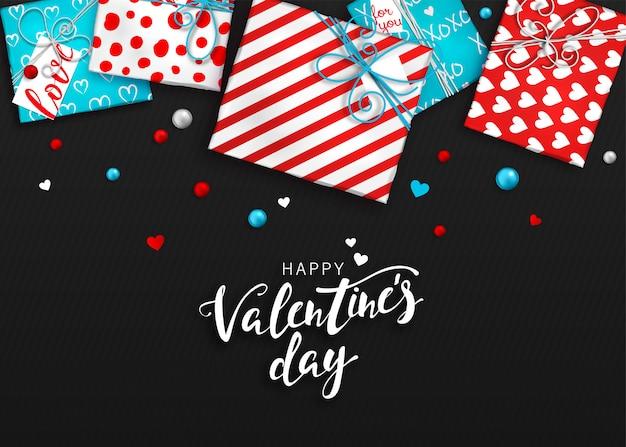 San valentino sullo sfondo. scatole regalo rosso e blu in carta da imballaggio Vettore Premium