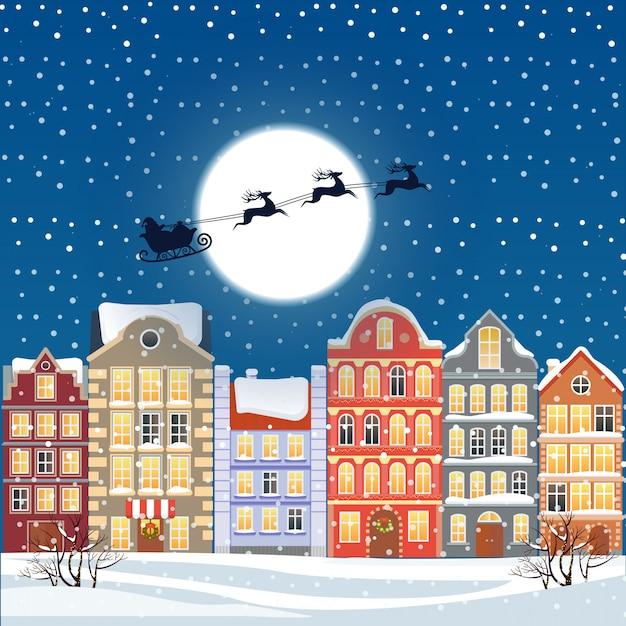 Santa volando attraverso il cielo notturno sotto la città vecchia Vettore Premium
