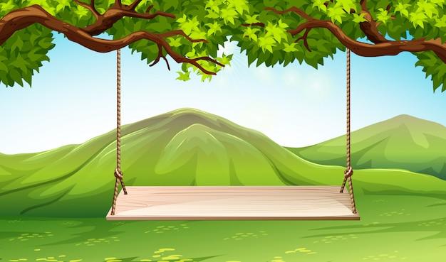 Scena con altalena in legno nel parco Vettore gratuito