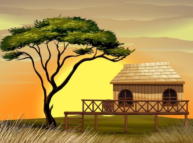 Scena con capanna di legno nel campo Vettore Premium