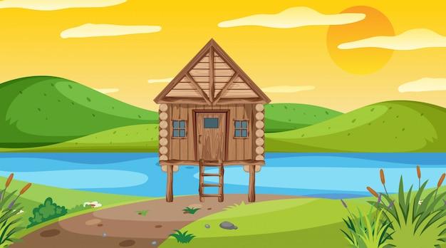 Scena con cottage in legno nel campo Vettore Premium