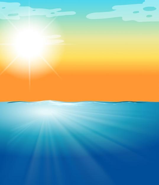 Scena dell'oceano con mare blu e sole splendente Vettore gratuito