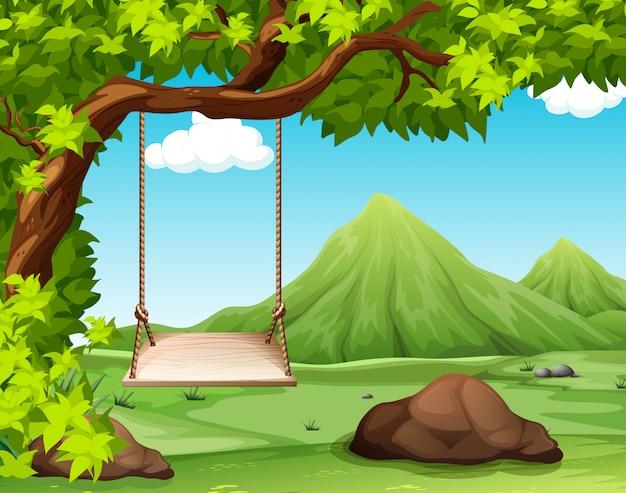 Scena della natura con swing sull'albero Vettore Premium