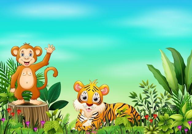 Scena della natura con una scimmia che sta sul ceppo e sulla tigre di albero Vettore Premium