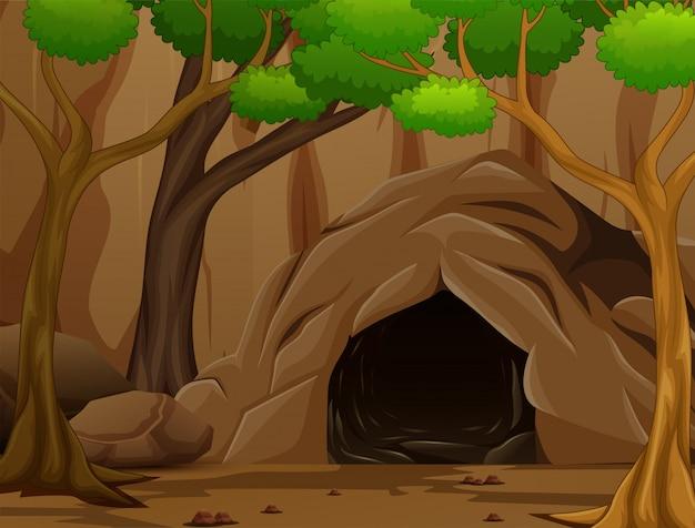 Scena di sfondo con una grotta scura e rocciosa Vettore Premium