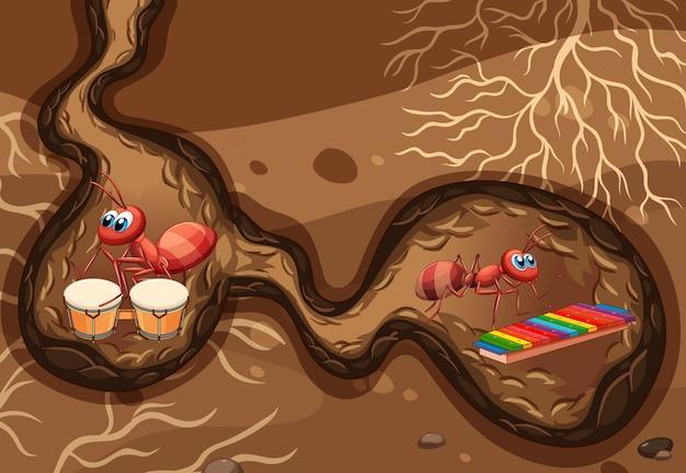 Scena sotterranea con le formiche che suonano musica nel buco Vettore gratuito
