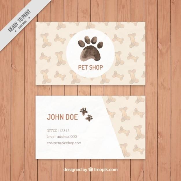 Scheda elegante del negozio di animali acquerello con ossa e impronta Vettore gratuito