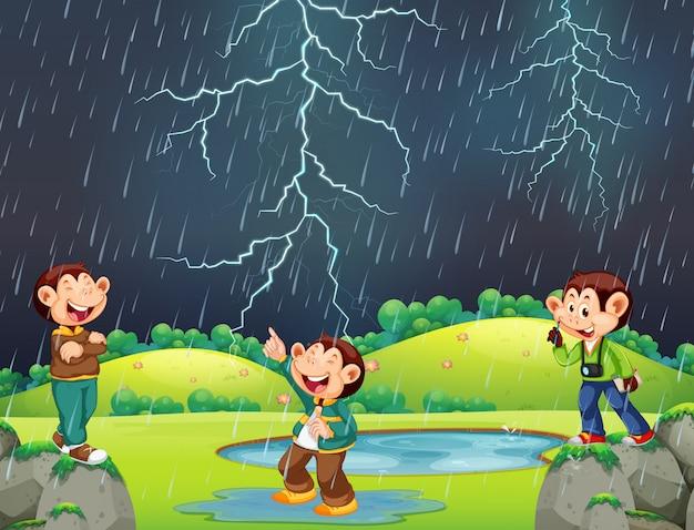 Scimmia felice nella scena delle piogge Vettore gratuito