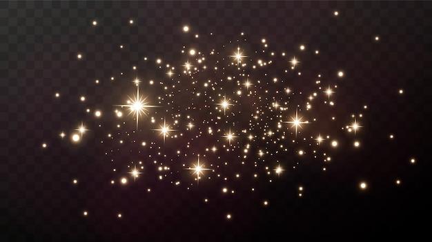 Scintille d'oro e stelle dorate brillano con un vero effetto di luce. l'esplosione dei coriandoli dorati. Vettore Premium