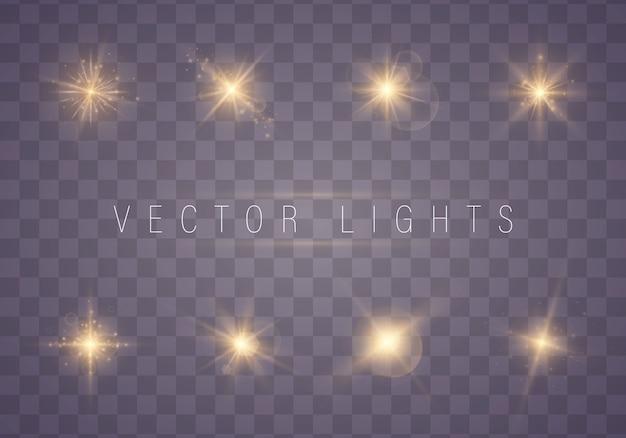 Scintille dorate delle luci isolate. set di stelle luminose. Vettore Premium