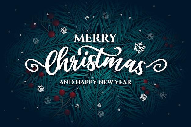 Scritte in merry christmas con foglie di pino Vettore gratuito