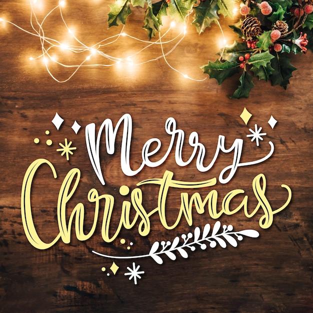 Scritte in merry christmas con luci Vettore gratuito