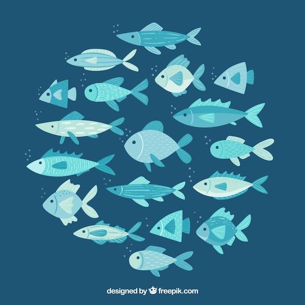 Scuola di stile disegnato a mano del fondo dei pesci Vettore gratuito