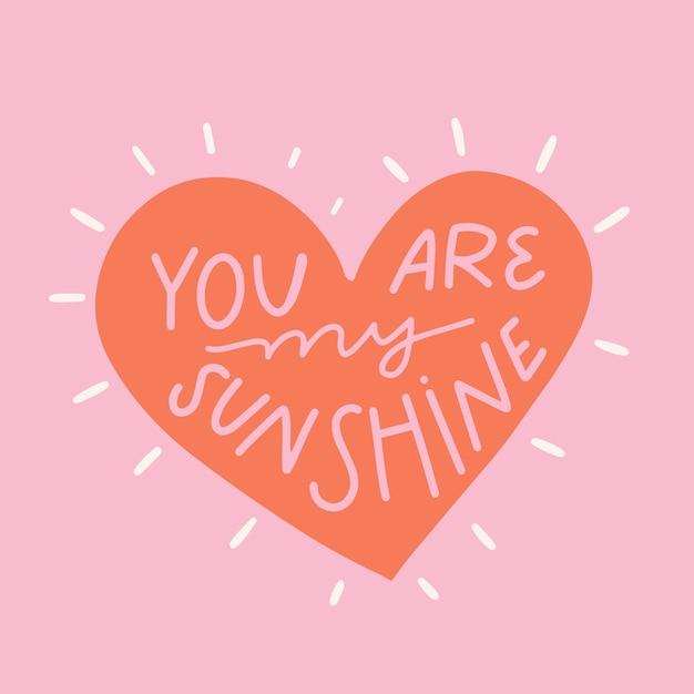 Sei il mio sole lettering su sfondo rosa Vettore gratuito