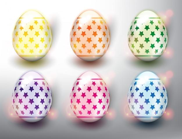 Set di 6 uova di pasqua colorate. colori pastello uova di pasqua con stelle. isolato sul pannello bianco. Vettore Premium
