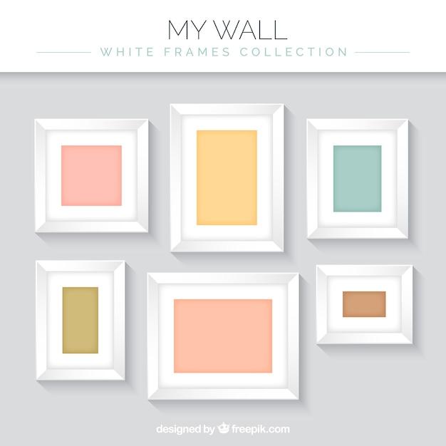 Set di cornici decorative sulla parete scaricare vettori for Set cornici da parete