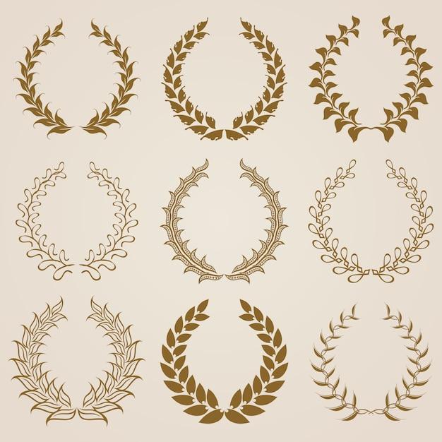 Set di corone di alloro d'oro vettoriale. Vettore Premium
