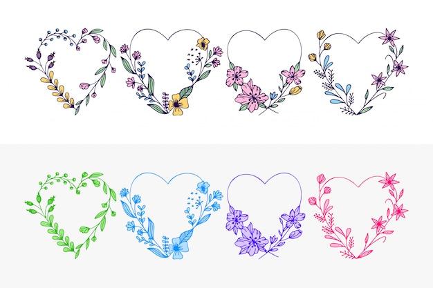 Set di cuori disegnati a mano corona con fiori stilizzati Vettore Premium