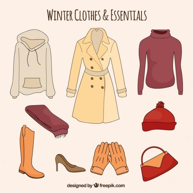 Set di disegnati a mano abiti invernali e essenziali Vettore gratuito