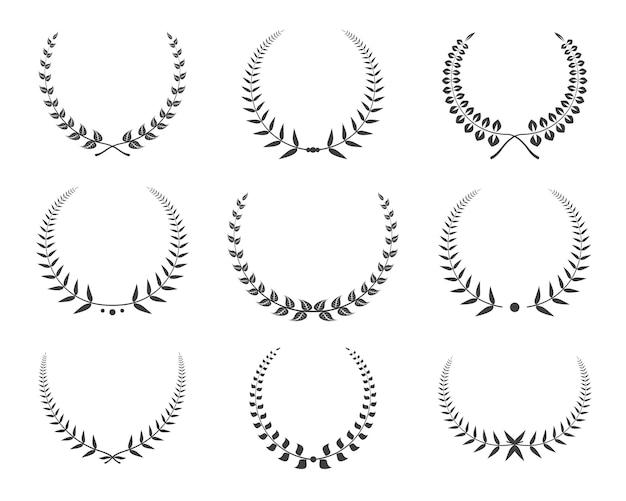 Set di icone di corone di alloro nero. Vettore Premium