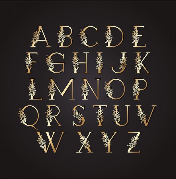 Set di lettere d'oro con foglie Vettore Premium