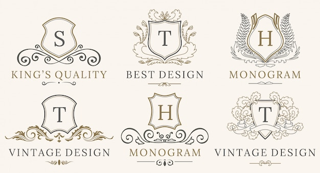 Set di loghi retro royal vintage shields. calligrafia di vettore elementi di design di marchio di lusso. Vettore Premium