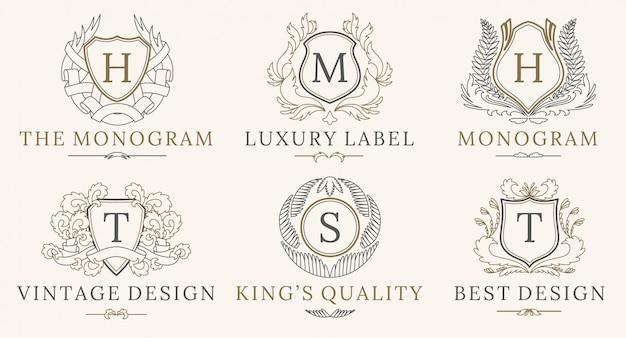 Set di loghi retro royal vintage shields Vettore Premium