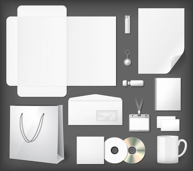 Set di mock up di identità aziendale vuota. blocco note, copertina cd, shopping bag, chiavetta usb, accendino, busta, tazza da caffè. Vettore Premium