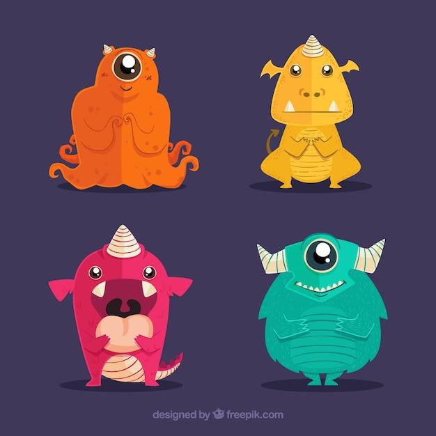 Set di mostri colorati in mano disegnato stile Vettore gratuito