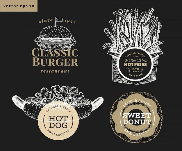 Set di quattro modelli di logo di cibo di strada. illustrazioni disegnate a mano degli alimenti a rapida preparazione di vettore sul bordo di gesso. hot dog, hamburger, patatine fritte, etichette retrò ciambella Vettore Premium