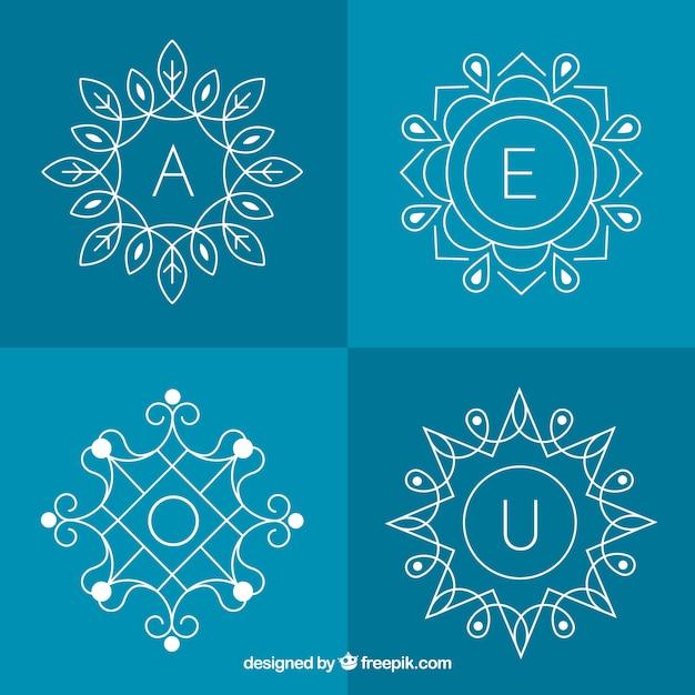 Set di quattro monogrammi floreali Vettore gratuito