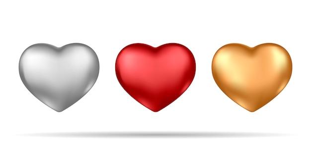 Set di realistici cuori d'argento, rossi e oro isolati su sfondo bianco. Vettore Premium