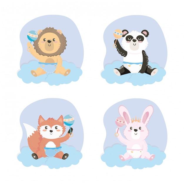 Set di simpatici animali con sonagli e pannolini Vettore gratuito