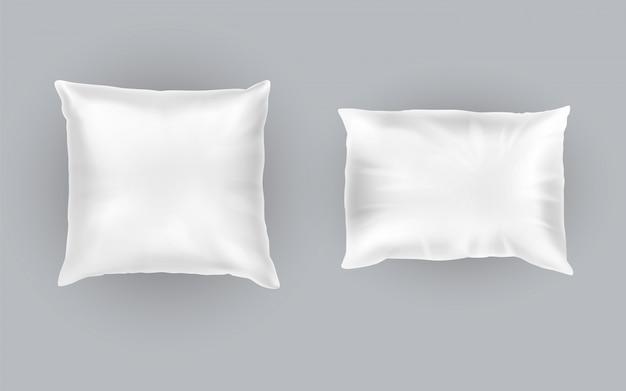 Set realistico di due cuscini bianchi, quadrati e rettangolari, morbidi e puliti Vettore gratuito