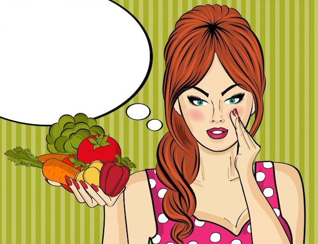 Sexy donna di arte pop con verdure in sua mano Vettore gratuito
