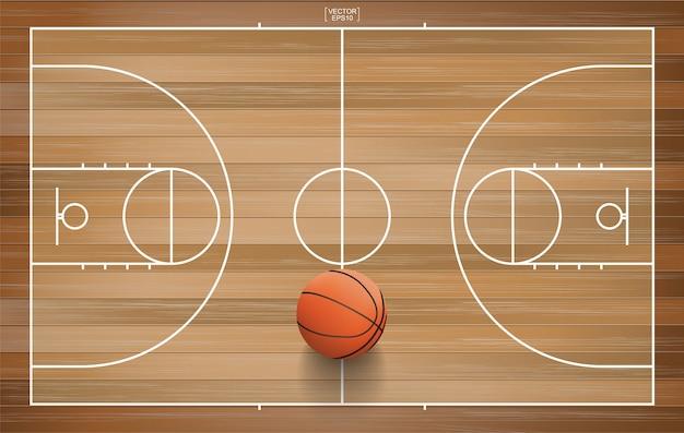 Sfera di pallacanestro sul campo in legno. Vettore Premium