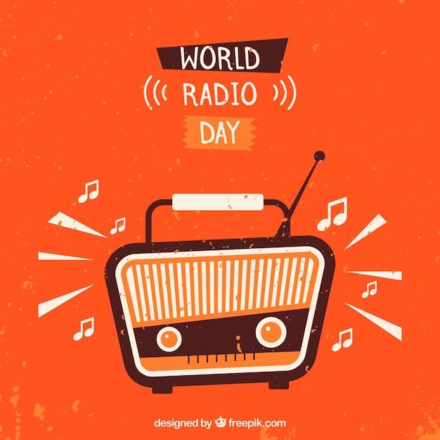 Sfondo arancione con la radio d'epoca per celebrare il giorno della radio mondo Vettore gratuito