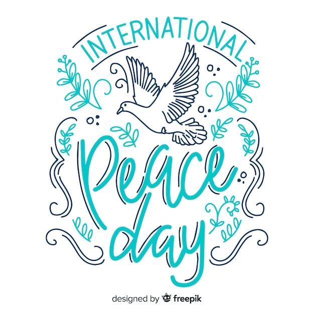 Sfondo colorato lettering giorno di pace Vettore gratuito