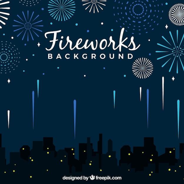 Sfondo della città con fuochi d'artificio Vettore gratuito