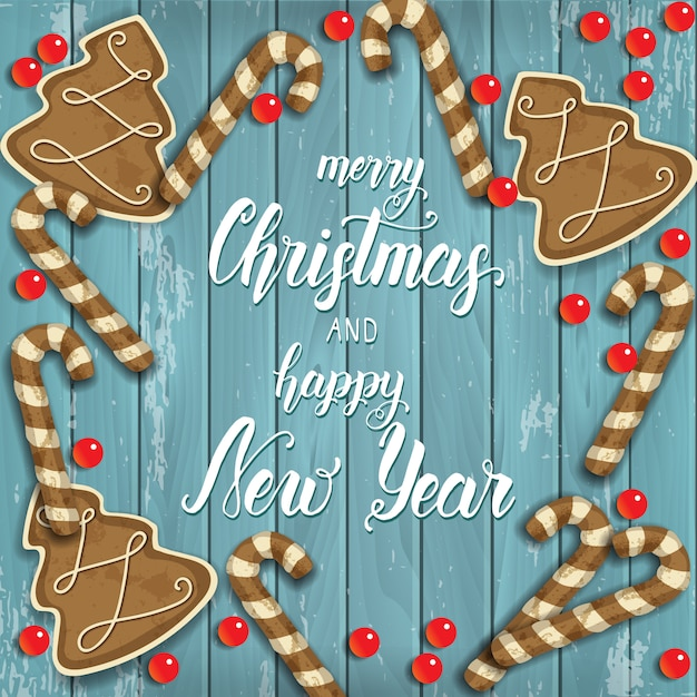 Sfondo di buon natale e felice anno nuovo, pan di zenzero festivo, perline e iscrizione di saluto su legno blu Vettore Premium