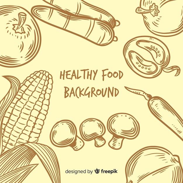 Sfondo di cibo sano disegnato a mano Vettore gratuito