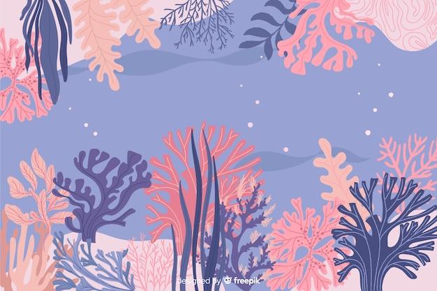 Sfondo di cornice corallo disegnato a mano Vettore gratuito