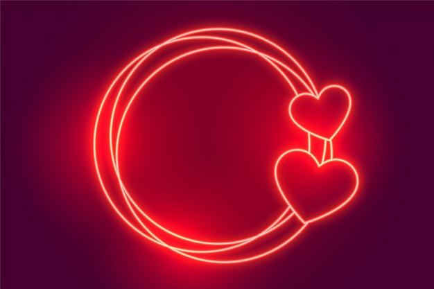 Sfondo di cornice di cuori al neon rosso incandescente Vettore gratuito