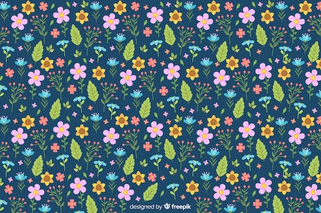 Sfondo di fiori e foglie colorate piatte Vettore gratuito