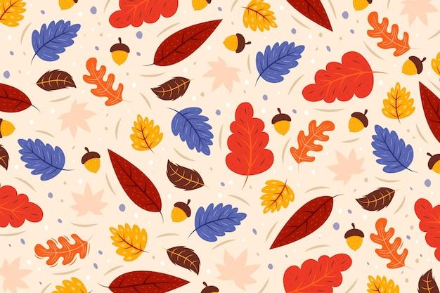 Sfondo di foglie autunnali disegnati a mano Vettore gratuito