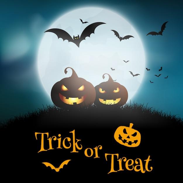 Sfondo di halloween con zucche contro un cielo illuminato dalla luna Vettore gratuito