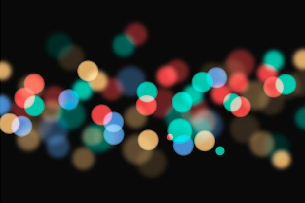 Sfondo di luci colorate bokeh Vettore gratuito