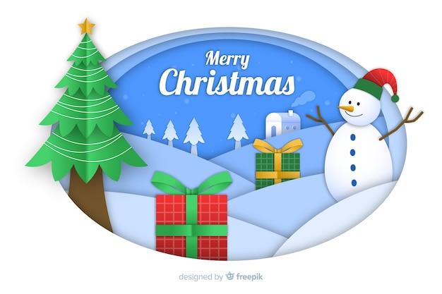 Sfondo di natale in stile carta con albero di natale e pupazzo di neve Vettore gratuito